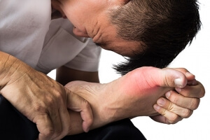 Man with pain in his foot